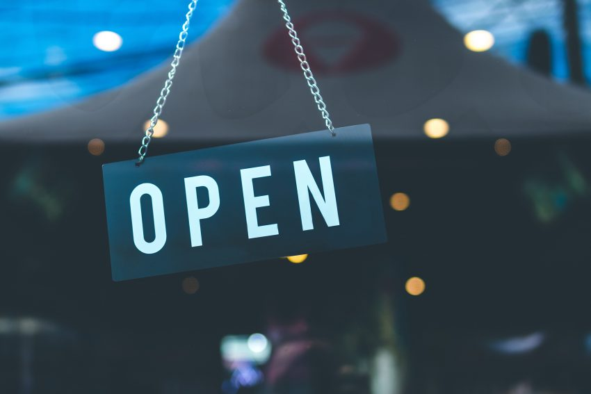 Photo of an open sign in a window