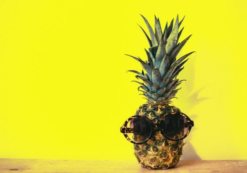 green-pineapple-fruit-with-brown-framed-sunglasses-beside-1161547